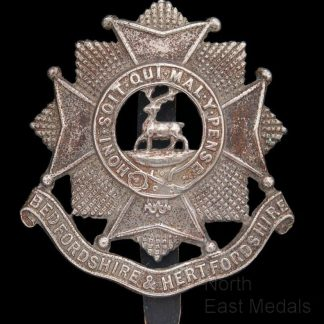 Bedfordshire and Hertfordshire Regiment cap badge White metal
