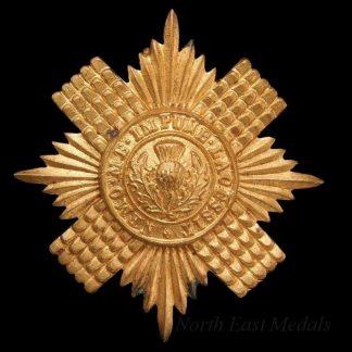 Scots Guards cap badge Gilding metal, loops north south