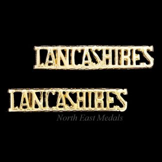 Pair of Queen's Lancashire Regiment Staybrite Shoulder Title Badges