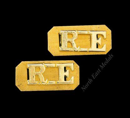 Pair of RE Royal Engineers Staybrite Shoulder Title Badges