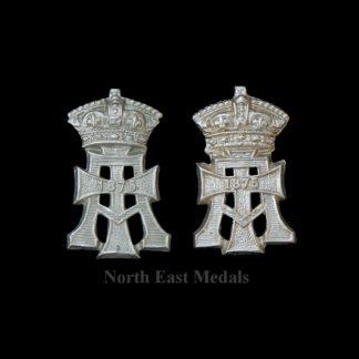 Pair of Yorkshire Regiment Green Howards Collar Badges