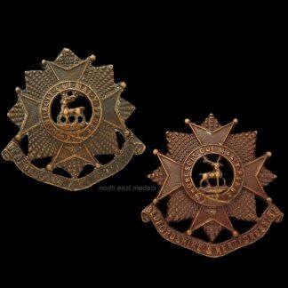 Pair of Bedfordshire & Hertfordshire Regiment Officers Bronze Collar Badges
