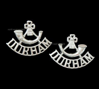 Pair of Durham Light Infantry DLI Staybrite Shoulder Title Badges